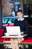 Young woman student or business sit in cafe outdoor use  laptop. Young elegant woman student or business sit in cafe outdoor use  laptop Stock Photos