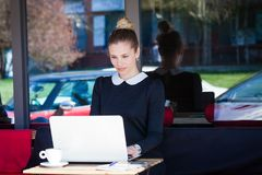 Elegant woman student or business sit in cafe outdoor use  lapto. Young elegant woman student or business sit in cafe outdoor use  laptop Royalty Free Stock Photography