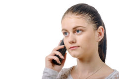 Young elegant woman talking on phone isolated on the white backg Royalty Free Stock Photos
