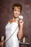 Young elegant woman in white dress Stock Images