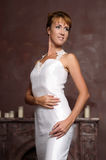 Young elegant woman in white dress Stock Photos