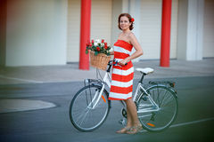 Young elegantly dressed woman with bicycle and a Stock Photography