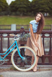 Young elegantly dressed woman with bicycle, summer and lifestyle Royalty Free Stock Images