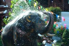 Young elephant splashing water. Royalty Free Stock Image