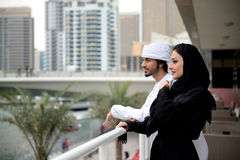 Young Emirati arab couple by the canal Stock Image