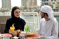 Young Emirati arab couple dining Stock Images