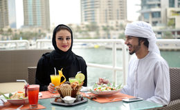 Young Emirati arab couple dining Royalty Free Stock Photo
