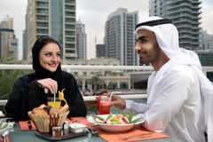 Young Emirati arab couple dining Royalty Free Stock Images