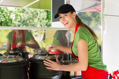 Young emloyee of an concession stand Royalty Free Stock Photography