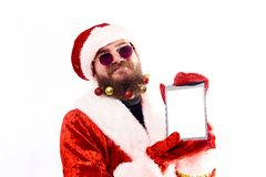 Young emotional bearded man in a Christmas costume. stock image