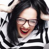 Young emotional  brunette woman wearing glasses Royalty Free Stock Photo