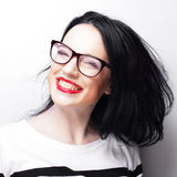 Young emotional  brunette woman wearing glasses Stock Photos
