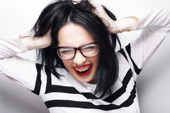 Young emotional  brunette woman wearing glasses Royalty Free Stock Photography