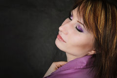 Young emotional girl in a purple shirt with a short haircut Stock Image