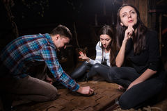 Young emotional people thinking, moving parts of a conundrum and. Trying to get out of the trap, escape the room game concept Stock Photography