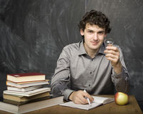The young emotional student with the books and red Stock Photos