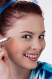 Young Emotional Woman With Cosmetic Pencil Stock Image