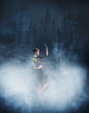 Young and emotional woman in fashion dress on the smoke Stock Photos