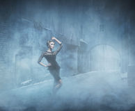Young and emotional woman in fashion dress on the smoke Stock Image