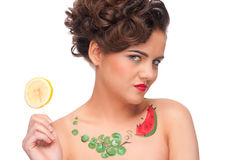 Young emotional woman with lemon canape Royalty Free Stock Images
