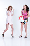 Young Emotional Woman With Paper Bag. Young woman with shopping bag in different actions and emotions stock images