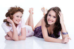 Young Emotional Women. Young women speaking and laughing stock image