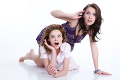 Young Emotional Women. Young women speaking and laughing stock photo