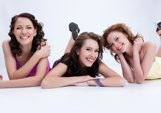 Young Emotional Women. Three emotioanl young women speaking and laughing royalty free stock photo