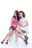 Young Emotional Women With Paper Bag. Two young women with shopping bag royalty free stock images