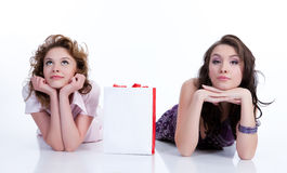 Young Emotional Women With Paper Bag Royalty Free Stock Photos