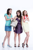 Young Emotional Women With Paper Bag. Young woman with shopping bag in different actions and emotions royalty free stock images