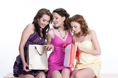Young Emotional Women With Paper Bag. Three young women with shopping bag stock images