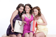 Young Emotional Women With Paper Bag. Young woman with shopping bag in different actions and emotions royalty free stock photography