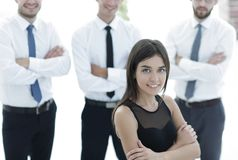 Young employee of the company, standing in front of their colleagues. Royalty Free Stock Photo
