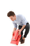 Young employee with falling folders Stock Photo