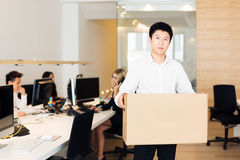 Young Employee Has Been Fired And Is Leaving Office Stock Photos