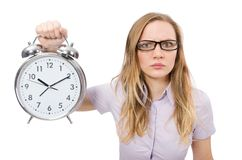 Young employee holding alarm clock isolated on the Royalty Free Stock Photos