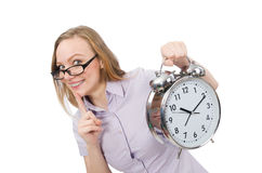 Young employee holding alarm clock isolated on Royalty Free Stock Photo