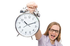 Young employee holding alarm clock isolated on Royalty Free Stock Photos