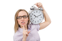 Young employee holding alarm clock isolated on Stock Photos