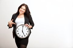 Young Employee Holding a Clock Stock Images