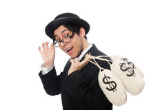 Young employee holding money bags isolated on Royalty Free Stock Photography