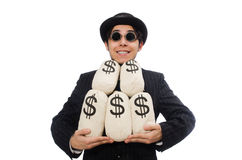 Young employee holding money bags isolated on Stock Images