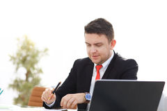 Young employee looking at computer monitor during working day. In office Stock Images