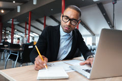 Young employee makes working notes at the office Royalty Free Stock Images