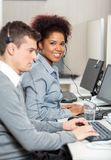 Young Employee With Male Colleague Working In Royalty Free Stock Photography