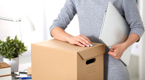 A young employee of the office is ready to move.  Stock Photo