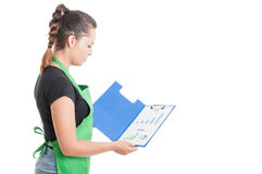 Young employee read the data on clipboard Royalty Free Stock Photo