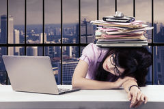 Young employee is sleeping in the office Royalty Free Stock Photography
