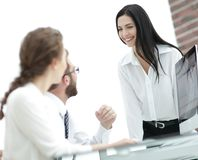 Young business woman talking to colleagues in the office Royalty Free Stock Photo